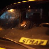 DOBRZYKOW, POLAND, MAY 23, 2010:.Rescue worker takes a short nap in a car late at night..The latest chapter of disastrous floods in Poland has been opened today, May 23, 2010, after Vistula river broke its banks and flooded over 25 villages causing evacualtion of most inhabitants..Photo by Piotr Malecki / Napo Images..DOBRZYKOW, POLSKA, 23/05/2010:.Mlody strazak ucial sobie krotka drzemke w samochodzie podczas nocy wypelnionej walka z zywiolem..Najnowszy akt straszliwych tegorocznych powodzi zostal rozpoczety dzis gdy Wisla przerwala waly na wysokosci wsi Swiniary kolo Plocka..Fot: Piotr Malecki / Napo Images ..
