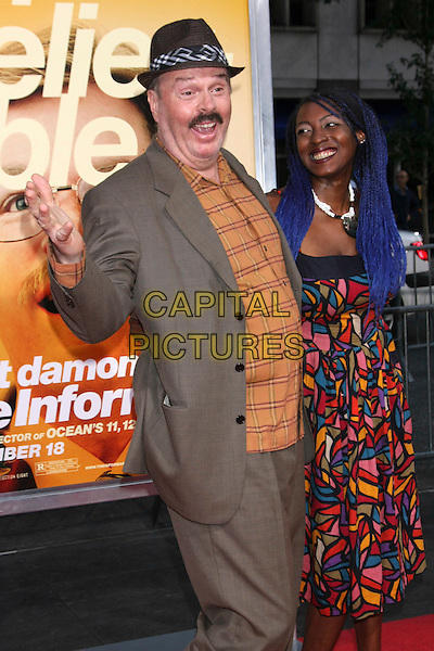 "RICK OVERTON & guest .Attending the New York Premiere of ""The Informant!"", New York, NY, USA, .September 15th 2009..Half length paid hat moustache mustache facial hair brown orange shirt print dress pink bag blue dyed hair suit hand funny face gesture mouth open .CAP/LNC/TOM.©LNC/Capital Pictures."