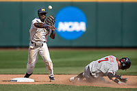 Michigan Wolverines second baseman Ako Thomas (4) turns a double play as Texas Tech Red Raiders baserunner Cody Masters (7) slides into second base during the NCAA College World Series on June 21, 2019 at TD Ameritrade Park in Omaha, Nebraska. Michigan defeated Texas Tech 15-3 and will play in the CWS Finals. (Andrew Woolley/Four Seam Images)