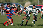 Manurewa centre C. Luteru tries to fend off E. Avei. Counties Manukau Premier Club Rugby, Ardmore Marist vs Manurewa played at Bruce Pulman Park, Papakura on the 10th of June 2006. Ardmore Maris won 18 - 11.