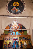 Albania. Tushemishtiht. Orthodox church. Jesus'Christ on the cross. An icon is a religious work of art, most commonly a painting, from the Eastern Orthodox Church and Oriental Orthodoxy. The most common subjects include Christ, Mary, saints and/or angels. Albanian script. Tushemisht is a village in the Korçë County, southeastern Albania. 21.5.2018 © 2018 Didier Ruef