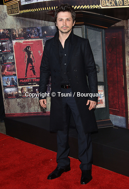 Freddie Rodirguez  arriving at the Grindhouse Premiere at the Orpheum Theatre In Los Angeles.<br /> <br /> full length<br /> eye contact<br /> long black coat