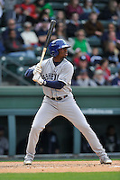 Outfielder Terry McClure (5) of the Asheville Tourists bats in a game against the Greenville Drive on Sunday, April 10, 2016, at Fluor Field at the West End in Greenville, South Carolina. Greenville won, 7-4. (Tom Priddy/Four Seam Images)