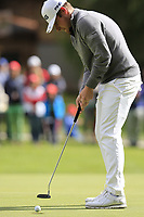 Tyrrell Hatton (ENG) takes his par putt on the 16th green during Sunday's Final Round of the 2017 Omega European Masters held at Golf Club Crans-Sur-Sierre, Crans Montana, Switzerland. 10th September 2017.<br /> Picture: Eoin Clarke | Golffile<br /> <br /> <br /> All photos usage must carry mandatory copyright credit (&copy; Golffile | Eoin Clarke)