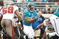 December 11, 2011:  Jacksonville Jaguars running back Maurice Jones-Drew (32) runs past Tampa Bay Buccaneers outside linebacker Quincy Black (58) during first half action between the Jacksonville Jaguars and the Tampa Bay Buccaneers played at EverBank Field in Jacksonville, Florida.  ........