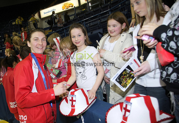 PICTURE BY VAUGHN RIDLEY/SWPIX.COM - Netball - The Co-Operative International Series - England v Jamaica, Third Test - Trent FM Arena, Nottingham, England - 26/02/09...Copyright - Simon Wilkinson - 07811267706...England's Rachel Dunn signs autographs.
