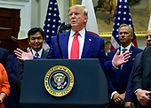 United States President Donald J. Trump takes questions from the press after the US-Japan Trade Agreement and US-Japan Digital Trade Agreement was signed in the Roosevelt Room of the White House in Washington, DC on Monday, October 7, 2019.<br /> Credit: Ron Sachs / Pool via CNP