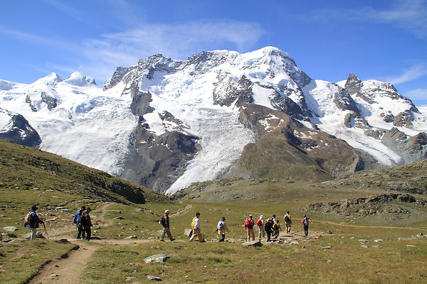 Hikers enjoy the Alps above Zermatt, Switzerland.