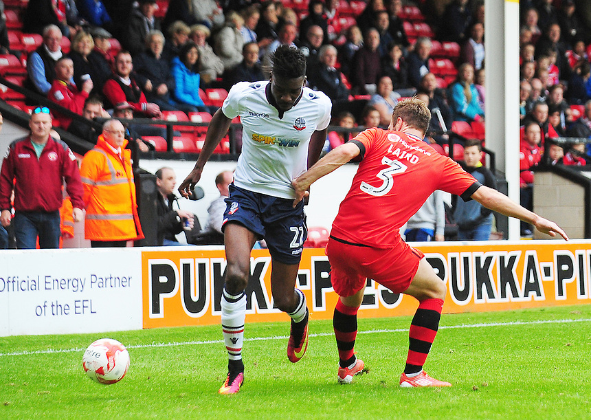 Bolton Wanderers' Sammy Ameobi under pressure from Walsall&rsquo;s Scott Laird<br /> <br /> Photographer Kevin Barnes/CameraSport<br /> <br /> The EFL Sky Bet League One - Walsall v Bolton Wanderers - Saturday 17th September 2016 - Banks's Stadium - Walsall<br /> <br /> World Copyright &copy; 2016 CameraSport. All rights reserved. 43 Linden Ave. Countesthorpe. Leicester. England. LE8 5PG - Tel: +44 (0) 116 277 4147 - admin@camerasport.com - www.camerasport.com