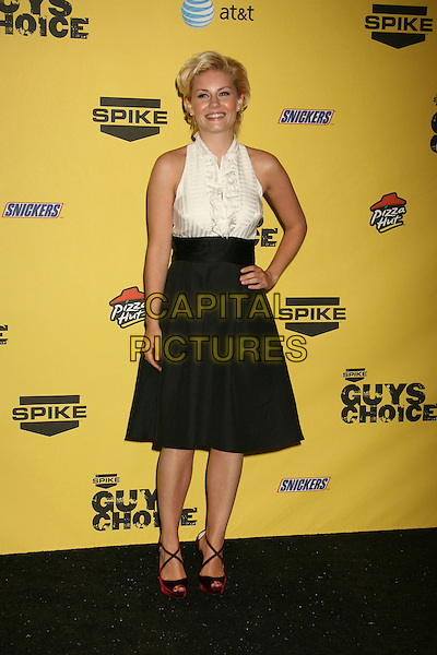 """ELISHA CUTHBERT.Spike TV's """"Guy Choice"""" Awards held at Radford Studios, Studio City, California, USA..June 9th, 2007.full length black high waisted A-line skirt pockets white blouse bib frills ruffles sleevless top fifties style red bag strappy shoes sandals hand on hip.CAP/ADM/RE.©Russ Elliot/AdMedia/Capital Pictures"""