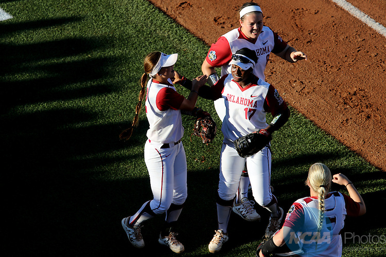 06 JUNE 2016: Oklahoma players celebrate after the first inning against Auburn University during the Division I Women's Softball Championship held at ASA Hall of Fame Stadium in Oklahoma City, OK.  University of Oklahoma defeated Auburn University in Game 1 by the final score of 3-2. Shane Bevel/NCAA Photos
