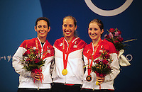 Aug. 9, 2008; Beijing, CHINA; Gold medal winner Mariel Zagunis (center) with silver medal winner Sada Jacobson (left) and bronze medal winner Becca Ward following the United States sweep of the womens fencing individual sabre final at the 2008 Beijing Olympic Games. Mandatory Credit: Mark J. Rebilas-