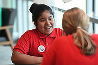 NWA Democrat-Gazette/J.T. WAMPLER Dulce Rodriguez, 11, visits with Linden Siems during the Amazing Shake Thursday April 11, 2019 at the Jones Center in Springdale. Students from Jones Elementary, Parson Elementary, and Grace Hill Elementary in Rogers competed to be named Amazing Shake champion. The Amazing Shake places an emphasis on teaching students leadership, manners, discipline, respect and professional conduct. Prior to the competition, students learn the nuances of professional human interaction as they are taught skills such as how to give a proper handshake, how to Òwork a room,Ó how to give a successful interview, and how to remain composed under pressure.