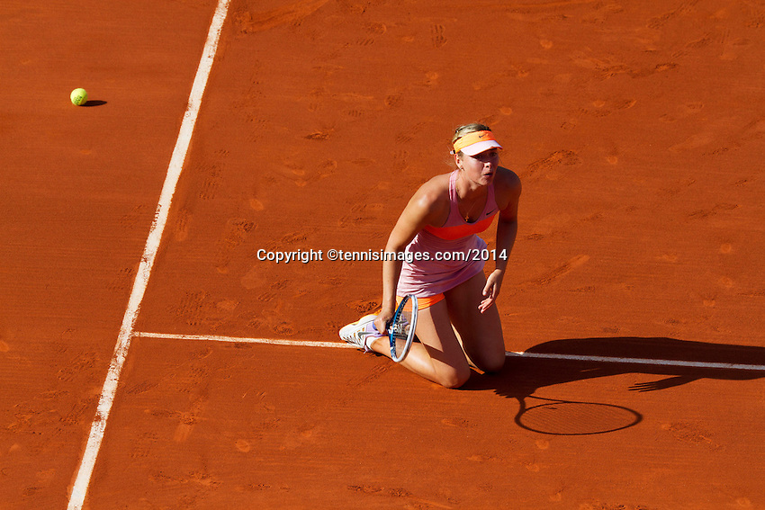 France, Paris, 04.06.2014. Tennis, French Open, Roland Garros, Maria Sharapova (RUS) goes down on her knees after defeating Halep in the final and wins Roland Garros<br /> Photo:Tennisimages/Henk Koster