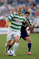 Jay Heaps (Revolution, blue) defends. The New England Revolution tie to Celtic FC, 1-1, July 19 at Gillette Stadium.