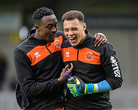 Blackpool's Joe Dodoo, left, with team-mate Myles Boney during the pre-match warm-up<br /> <br /> Photographer Chris Vaughan/CameraSport<br /> <br /> The EFL Sky Bet League One - Burton Albion v Blackpool - Saturday 16th March 2019 - Pirelli Stadium - Burton upon Trent<br /> <br /> World Copyright &copy; 2019 CameraSport. All rights reserved. 43 Linden Ave. Countesthorpe. Leicester. England. LE8 5PG - Tel: +44 (0) 116 277 4147 - admin@camerasport.com - www.camerasport.com