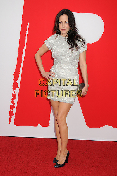 Mary-Louise Parker<br /> Attending the &quot;Red 2&quot; Los Angeles Film Premiere held at the Regency Westwood Village Theatre, Westwood, California, USA, 11 July 2013.<br /> full length dress short sleeved white silver clutch bag black shoes hand on hip <br /> CAP/ADM/BP<br /> &copy;Byron Purvis/AdMedia/Capital Pictures