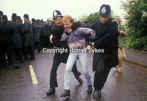 Miners Strike. Orgreave  Near Rotherham Yorkshire 1984. Miner arrested by police.
