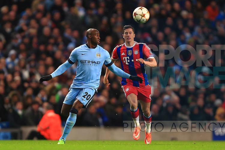 Eliaquim Mangala of Manchester City and Robert Lewandowski of Munich - Manchester City vs. Bayern Munich - UEFA Champion's League - Etihad Stadium - Manchester - 25/11/2014 Pic Philip Oldham/Sportimage