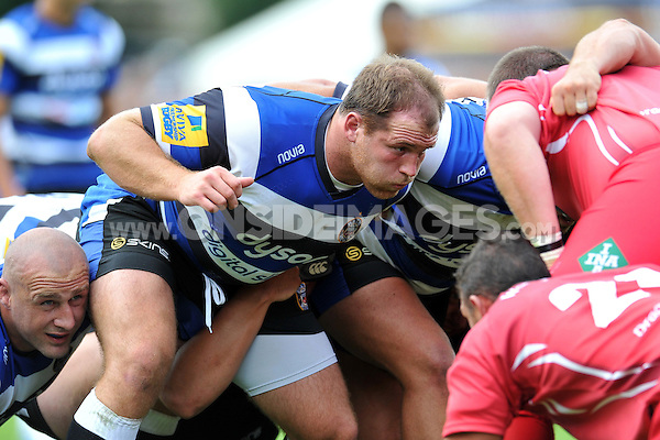 Henry Thomas prepares to scrummage against his opposite number. Pre-season friendly match, between Bath Rugby and the Scarlets on August 16, 2014 at the Recreation Ground in Bath, England. Photo by: Patrick Khachfe / Onside Images