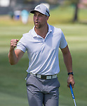 Adam Thielen celebrates after sinking a long putt during the American Century Championship at Edgewood Tahoe Golf Course in Stateline, Nevada, Saturday, July 14, 2018.