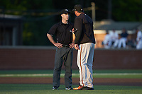 Frederick Keys manager Ryan Minor (right) argues a call with base umpire Tom Hanahan during the game against the Buies Creek Astros at Jim Perry Stadium on April 28, 2018 in Buies Creek, North Carolina. The Astros defeated the Keys 9-4.  (Brian Westerholt/Four Seam Images)