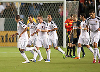 CARSON, CA – April 2, 2011: LA Galaxy players Juninho (19), Chris Birchall (8), Miguel Lopez (25), Juan Pablo Angel (9) and Omar Gonzalez (4) celebrate Leonardo's (22) goal during the match between LA Galaxy and Philadelphia Union at the Home Depot Center, March 26, 2011 in Carson, California. Final score LA Galaxy 1, Philadelphia Union 0.