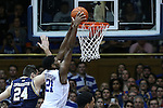 07 February 2015: Duke's Amile Jefferson (21) dunks the ball behind Notre Dame's Pat Connaughton (24). The Duke University Blue Devils hosted the University of Notre Dame Fighting Irish at Cameron Indoor Stadium in Durham, North Carolina in a 2014-16 NCAA Men's Basketball Division I game. Duke won the game 90-60.