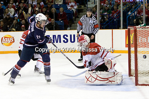 Derek Stepan (USA - 21), Jake Allen (Canada - 1) - Team Canada defeated Team USA 5-4 (SO) on Thursday, December 31, 2009, at the Credit Union Centre in Saskatoon, Saskatchewan, during the 2010 World Juniors tournament.