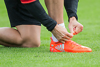 Gareth Bale ties his laces during the Wales open Training session ahead of the opening FIFA World Cup 2018 Qualification match against Moldova at The Vale Resort, Cardiff, Wales on 31 August 2016. Photo by Mark  Hawkins / PRiME Media Images.
