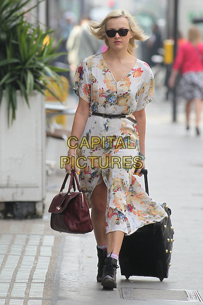 Fearne Cotton in central London, England..May 24th, 2012.full length white blue yellow floral print dress sunglasses shades wheelie suitcase luggage black boots maroon burgundy bag purse .CAP/HIL.©John Hillcoat/Capital Pictures.