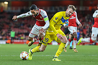 Theo Walcott of Arsenal wins a penalty as he is fouled by Nemanja MILUNOVIC of FC BATE Borisov during the UEFA Europa League match between Arsenal and FC BATE Borisov  at the Emirates Stadium, London, England on 7 December 2017. Photo by David Horn.