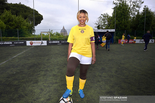 """The women's soccer team of Vatican City. 26 may 2019<br /> Vatican captain Eugene Tcheugoue<br /> <br /> Women's football arrives at the Vatican, with what can be considered in all respects the women's national football team of the Holy See. The Vatican representative, announced in recent weeks, made its debut yesterday afternoon, Sunday 26 May, in the sports center of the Knights of Columbus, against the Roma women's team of Roma.<br /> The girls that make up the team are all Vatican employees or wife and daughters of staff of the Holy See, plus some players from the Bambino Gesù hospital team who joined for this 11-a-side football match. «We are born in an amateur way - he tells the attacker and captain of the Vatican Eugene Tcheugoue - and playing together represents for us above all a way to get to know and be together ».<br /> <br /> The young soccer player, a graduate in theology and a native of Cameroon, has no doubts about the great important symbolism of the team: """"Many of us are mothers even before they are employees or at least daughters and wives, so in the first place for us is the metaphor of football as a gym of life. Sport in general - says Eugene Tcheugoue - conveys a fundamental message, both for the new generations and in particular for women """"."""