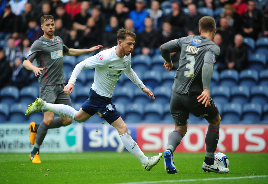 Preston North End's Joe Garner is tackled by Rotherham United's Joe Skarz <br /> <br /> Photographer Chris Vaughan/CameraSport<br /> <br /> Football - The Football League Sky Bet League One Play-Off First Leg - Preston North End v Rotherham United - Saturday 10th May 2014 - Deepdale - Preston<br /> <br /> &copy; CameraSport - 43 Linden Ave. Countesthorpe. Leicester. England. LE8 5PG - Tel: +44 (0) 116 277 4147 - admin@camerasport.com - www.camerasport.com