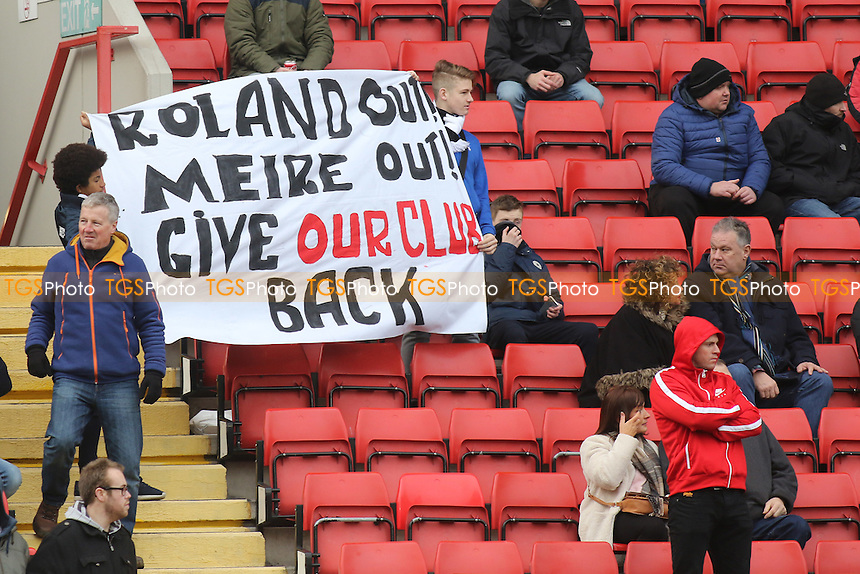 Charlton fans hold up a banner showing they want Roland & Meire Out during Charlton Athletic vs Bristol City, Sky Bet Championship Football at The Valley