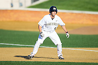 Grant Shambley (43) of the Wake Forest Demon Deacons takes his lead off of first base against the Duke Blue Devils at Wake Forest Baseball Park on April 25, 2014 in Winston-Salem, North Carolina.  The Blue Devils defeated the Demon Deacons 5-2.  (Brian Westerholt/Four Seam Images)