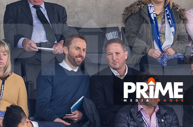 Temporary England Manager Gareth Southgate enjoys the match from the stands with coach Steve Holland during the Premier League match between Leicester City and Southampton at the King Power Stadium, Leicester, England on 2 October 2016. Photo by Andy Rowland.