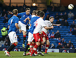 Chris Hegarty scores with a header to open the scoring for Rangers in the friendly match against Linfield