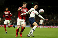 14th January 2020; Tottenham Hotspur Stadium, London, England; English FA Cup Football, Tottenham Hotspur versus Middlesbrough; Son Heung-Min of Tottenham Hotspur holds off the challenge from Paddy McNair of Middlesbrough - Strictly Editorial Use Only. No use with unauthorized audio, video, data, fixture lists, club/league logos or 'live' services. Online in-match use limited to 120 images, no video emulation. No use in betting, games or single club/league/player publications