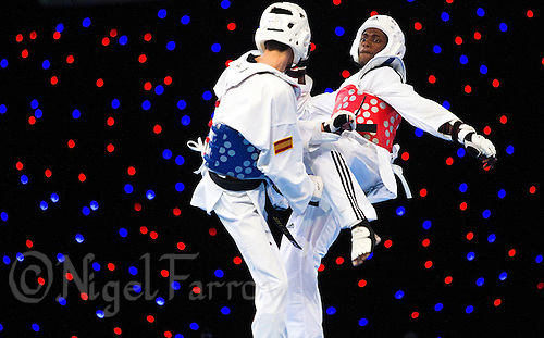 04 MAY 2012 - MANCHESTER, GBR - Moussa Cisse (FRA) of France (on right) aims a kick at Joel Gonzalez Bonilla of Spain during the men's -58kg category final at the 2012 European Taekwondo Championships at Sportcity in Manchester, Great Britain .(PHOTO (C) 2012 NIGEL FARROW)