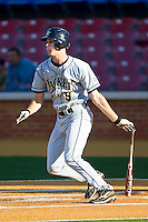 Jacob Esch #9 of the Georgia Tech Yellow Jackets follows through on his swing against the Wake Forest Demon Deacons at Gene Hooks Field on April 16, 2011 in Winston-Salem, North Carolina.  Photo by Brian Westerholt / Four Seam Images