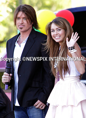 "MILEY CYRUS AND DAD BILLY RAY CYRUS.""Hannah Montana: The Movie"", Madrid_21/04/2009.Mandatory Credit Photo: ©NEWSPIX INTERNATIONAL..**ALL FEES PAYABLE TO: ""NEWSPIX INTERNATIONAL""**..IMMEDIATE CONFIRMATION OF USAGE REQUIRED:.Newspix International, 31 Chinnery Hill, Bishop's Stortford, ENGLAND CM23 3PS.Tel:+441279 324672  ; Fax: +441279656877.Mobile:  07775681153.e-mail: info@newspixinternational.co.uk"