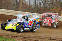 Jimmy Phelps and Larry Wight battle for position during a heat race at Bridgeport Speedway