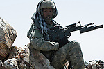 Sgt. Alexander Ditsen, 29, of Cape Coral, Fla., a soldier with Company A, 2nd Battalion, 503rd Parachute Infantry Regiment yells for more grenade rounds as his squad ambushes a group of Taliban fighters who have stumbled upon them during an operation in the Narang valley, in Kunar province, Afghanistan. The soldiers were protecting a team during a two-day mission that directed air and artillery strikes on Taliban positions in the valley below. May 17, 2008. DREW BROWN/STARS AND STRIPES