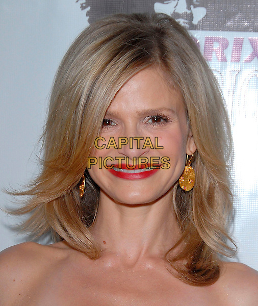 KYRA SEDGWICK.attends The Los Angeles Confidential Pre-Emmy Party to Honor Kyra Sedgwick held at The Cabana Club in Hollywood, California, USA,  August 25, 2006.portrait headshot red lipstick sedgewick eyes to camera eye contact.Ref: DVS.www.capitalpictures.com.sales@capitalpictures.com.©Debbie VanStory/Capital Pictures