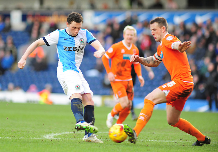Blackburn's Corry Evans gets a shot away under pressure from Blackpool's Peter Clarke<br /> <br /> Photographer Andrew Vaughan/CameraSport<br /> <br /> Football - The Football League Sky Bet Championship - Blackburn Rovers v Blackpool - Saturday 21st February 2015 - Ewood Park - Blackburn<br /> <br /> &copy; CameraSport - 43 Linden Ave. Countesthorpe. Leicester. England. LE8 5PG - Tel: +44 (0) 116 277 4147 - admin@camerasport.com - www.camerasport.com