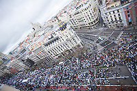 Thousands of people march in Spain to protest plans to privatize public health services