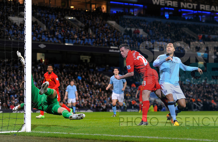 Joe Hart of Manchester City saves from Jamie Carragher of Liverpool - Barclays Premier League - Manchester City vs Liverpool - Etihad Stadium - Manchester - 03/02/13 - Picture Simon Bellis/Sportimage