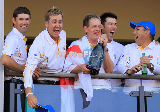 European Team Players Padraig Harrington, Ian Poulter,  Luke Donald and Ross Fisher celebrate victory on the clubhouse balcony at the end of The Final Day Monday of the 2010 Ryder Cup at the Celtic Manor Resort. (Photo Manus O'Reilly/Golffile 2010)