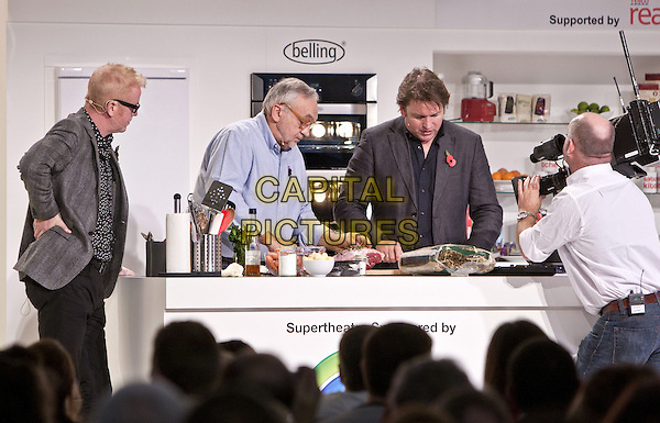 Chris Evans and James Martin.BBC Good Food Show London 2012, Olympia, Kensington, London, England..November 10th 2012.half length grey gray suit jacket glasses cook cooking camera side profile .CAP/MM/PP.©Mike Mustard/PP/Capital Pictures
